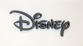 Disney company logo sign. Grey plastic letters on the white wall Stock Images