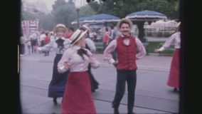 Disney daytime street parade impressions. Usa, California, Los Angeles, June 1978. Four shot sequence. dancers at the daytime lineup for the celebration of stock video