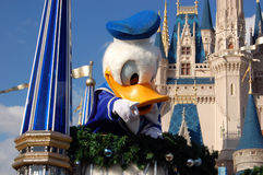 Disney Donald Duck during a parade. December 2007, Disney Magic Kingdom (Orlando) - Disney character Donald Duck with Cinderella castle in the background during Stock Image