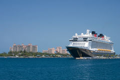 Disney Dream. Docked in Nassau, The Bahamas. Paradise island in the background Royalty Free Stock Photos