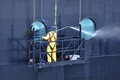 Disney Dream cruise ship crew. Members working washing the ship in Nassau, Bahamas, USA Stock Photo