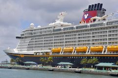 Disney Dream cruise ship in Nassau, Bahamas. Disney Dream is a cruise ship operated by Disney Cruise Line, part of The Walt Disney Company royalty free stock images