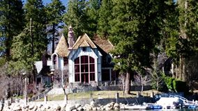 Disney executive Mike Eisner and Brian Wilson Lake Arrowhead estate. Arrowhead Lake Queen Celebrity Mountain Boat Tour featuring Disney studios executive Michael stock video