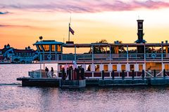 Disney Ferry boat and partial view of Grand Floridian Resort & Spa on sunset background at Walt Disney World  area 1 royalty free stock photo
