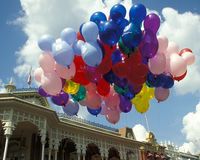 Disney Magic Kingdom Balloons in Liberty Square. Lots of helium balloons float in the sky at Disney Magic Kingdom, Liberty Square, Disney World, Orlando, Florida stock photos