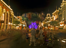 Disney Magic Kingdom night scene. A family buying some balloons in Disney`s Magic Kingdom at night Royalty Free Stock Photo