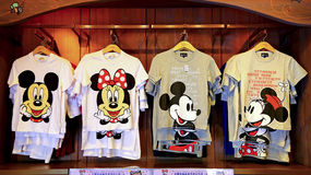 Disney mickey and minnie mouse t-shirts collection. Collection of mickey and minnie mouse disney t-shirts for girl on display for sale at the store in disneyland Royalty Free Stock Photo