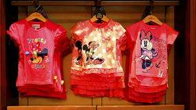 Disney minnie mouse t-shirts collection. Collection of mickey and minnie mouse disney t-shirts for girl on display for sale at the store in disneyland hong kong Royalty Free Stock Photos
