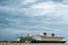 Falmouth, Jamaica - June 03 2015: Disney Fantasy and Royal Caribbean Independence of the Seas cruise ships docked side by side at. Disney and Royal Caribbean royalty free stock photos