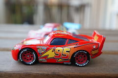 Disney`s Cars. Lightning McQueen and other toy car from the Disney Pixar movie Cars on a wooden table royalty free stock photography