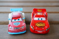 Disney`s Cars. Lightning McQueen and other toy car from the Disney Pixar movie Cars on a wooden table stock photography