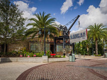 Disney Springs Mall Hangar Bar. Beautiful outdoor shopping mall in Orlando, Florida with palm trees, restaurants, boutique stores and special food shops.  A Royalty Free Stock Images
