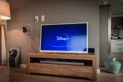 Free Disney+ Startscreen On Tv. Disney+ Online Video, Content Streaming Subscription Service. Disney Plus, Star Wars, Marvel, Pixar, Na Stock Photo - 159694760