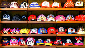 Disney theme hats on shelves stock image
