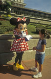 Disney World Magic Kingdom - Minnie Mouse and fan Royalty Free Stock Image