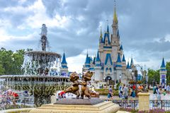 Disney World Orlando Florida Magic Kingdom chip and dale statue. Chip and dale statue with the cinderella castle at walt disney world orlando florida royalty free stock photography