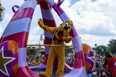 Disney World Orlando Florida Magic Kingdom parade pluto. Pluto at the parade  disney world orlando florida Stock Photo