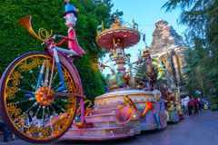 Disneyland Character Parade. Thousands of visitors at Disneyland each day visit the resort park. Many line the street to watch the iconic Fantasy Parade with royalty free stock images