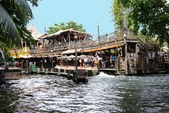 Disneyland Jungle Cruise Dock. Disneyland Jungle Cruise ride features lions, hippos, waterfalls, African natives and more as the steamer boat navigates the river royalty free stock photography