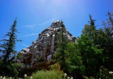 Disneyland Matterhorn Mountain Trees Sunny Day. Disneyland Matterhorn rollercoaster ride inside the Matterhorn Mountain. In the folklore of Nepal, the Yeti or royalty free stock photography
