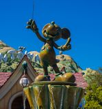 Disneyland Mickey Mouse Conductor statue. Disneyland Toontown Mickey Mouse statue conducts the musical fountain. This statue greets visitors to ToonTown inside Stock Image