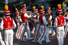 Disneyland music players. Band of trumpet, drum and saxophone players performs during the parade at disnelyland, hong kong royalty free stock images