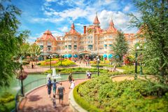 The Disneyland Paris Hotel. A view of the Disneyland Hotel at Eurodisney in Paris with tourists heading for the Disney Park on a beautiful summers day Stock Image