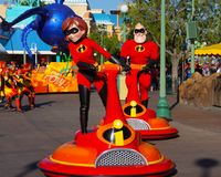 Disneyland Pixar Parade The Incredibles. Pixar animated characters from The Incredibles are featured in Disneyland Parade stock photos