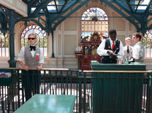 Disneyland Railway station. Paris,France,July 11th 2010: Officers doing activities in the Disneyland railway station just before the arrival of the train and royalty free stock photos