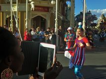 Disneyworld employee smiling during main street parade in the afternoon