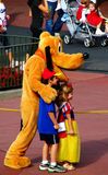 Disneyworld Pluto and Children. Boy and girl with Pluto in Disneyworld's Magic Kingdom Stock Image