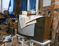 Disorder. Messy abandoned garage full of stuff Stock Images