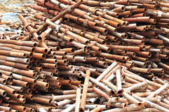 Disorder rusty steel pipes. In warehouse Stock Image
