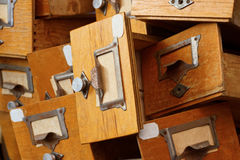 Disorderly group of old wooden drawers Royalty Free Stock Photography