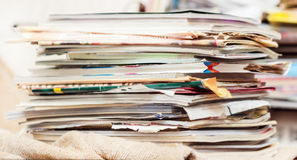 Disorderly pile of magazines and newspaper Royalty Free Stock Images