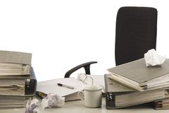 Disorganized desktop. In an office with folders and papers. White background Royalty Free Stock Images