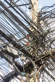 Disorganized, Messy electrical cables in Thailand.  Royalty Free Stock Photo