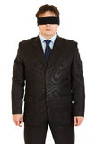 Disoriented businessman with blindfold on eyes. Isolated on white Royalty Free Stock Photos