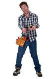 Disoriented man holding a multimeter. A disoriented man holding a multimeter Royalty Free Stock Images