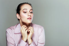 Disoriented woman in pink blouse. Portrait of a young sad disoriented woman in pink blouse, she looks down Stock Image