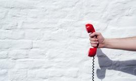 Disparado de um receptor de telefone da linha terrestre com espaço da cópia para o indivi Foto de Stock Royalty Free