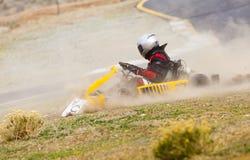 Disparaissent l'accident de coureur de kart images libres de droits