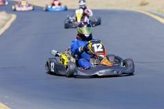 Disparaissent le pilote de course #12 de kart Photos stock