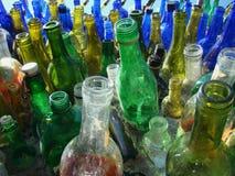 Disparaissent le vert avec les bouteilles réutilisées Photo libre de droits