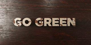 Disparaissent le vert - titre en bois sale sur l'érable - image courante gratuite de redevance rendue par 3D Photographie stock