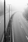 Disparaition dans le brouillard Photo stock