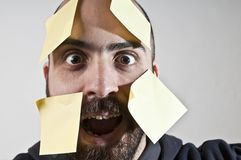 Disparate man with postit on his face Stock Image