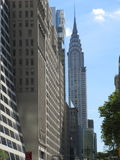 The Disparate styles of New York City. View towards the Crysler building taking in the modern and older architectural styles of NYC stock image