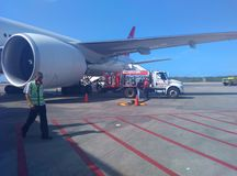 Dispatch of fuel to passenger aircraft in commercial flight at Maiquetía Venezuela airport. Aerial airplane travel tourism business transportation operation stock images