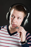 Dispatcher. Man in headphones with a microphone Royalty Free Stock Image